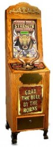 "Coin-operated ""Grab the bull by the Horns"" strength tester machine made by impulse industries."