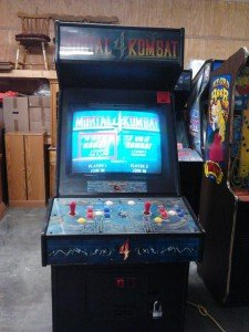 Liquidation sale of video arcade games that need repair like this Mortal Kombat 4
