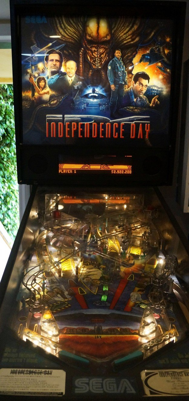 Backglass and playfield view of Independence Day pinball machine for sale.