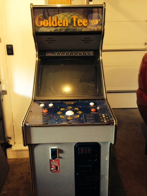 """Golden Tee video arcade game """"Fore""""."""